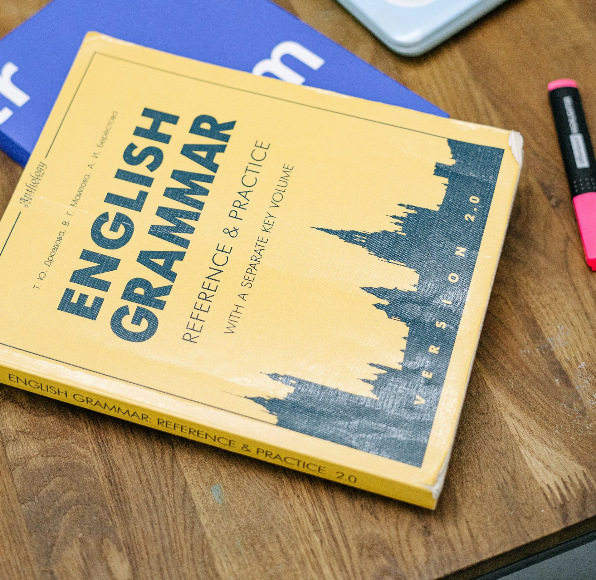 A book titled English Grammar on a table